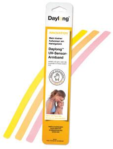Daylong UV-Sensor-Armbänder Verpackung und Armbänder in 3 Stufen: unbenutzt, der Sonne ausgesetzt und bei erreichter maximaler Sonnendosis.